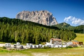 Hotel Sella with on the background the Langkofel (Sasso Lungo) from the North